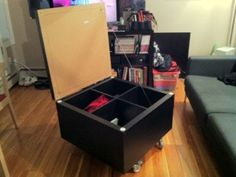 Ikea Hack  2 x 2 Expedit with casters and a cover, ingenious!  Coffee table, toy chest, could upholster the top for a big ottoman!