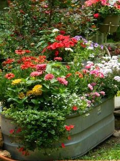 Add annuals in an old galvanized tub for a colorful display in your garden- unique planters #GardenLandscapingHouse #uniqueoutdoorplanter