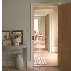 Araucana Turquoise was used for a living-room color, Ameraucana Buff for a hallway, and Araucana Sage in a dining room. (Paint colors a joint collection from Fine Paints of Europe and Martha Stewart Living.)