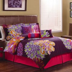 Fun bright large scale flowers on a bed of rich purple color make F...