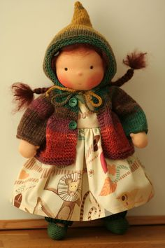 Such a cute doll.  This artist does the best job on hair and faces and clothes.  So sweet.