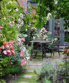 A favorite dinner spot, this patio is screened from neighboring houses and nestled beside a rose-covered fence.