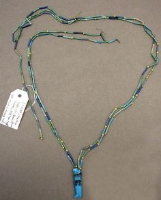 Ancient Egyptian necklace with Horus amulet made from faience. XVIII Dynasty in the New Kingdom (1550 - 1069 BCE).