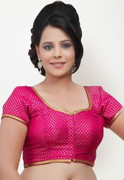 Pink coloured saree blouse for women by Salwar Studio. Crafted from brocade this short sleeve saree blouse has round neck .