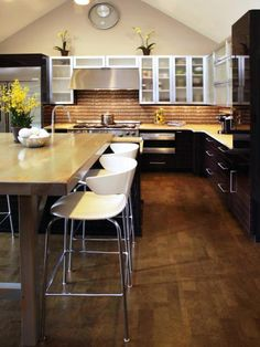 Bring together friends and family in the coziest room in your home with these ideas for kitchen island chairs.