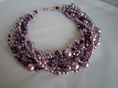 Pink and purple pearl and crystal statement necklace via Etsy