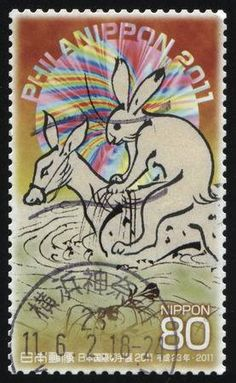 18 MARCH 2016: stamp printed by Japan, shows a hare riding a donkey