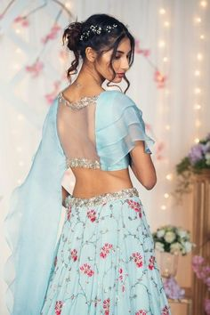 Powder Blue Chiffon Lehenga with Organza Ruffles Blouse. Hand Embroidered thread and zardosi details on the lehenga and blouse. Stylish Blouse Design, Fancy Blouse Designs, Blouse Neck Designs, Indian Fashion Dresses, Indian Gowns Dresses, Indian Designer Outfits, Sleeves Designs For Dresses, Designer Blouse Patterns, Lehenga Designs
