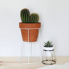 Make some simple wire plant stands using common household items!