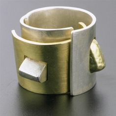 Ring | Rana Mikdash.   From the Puzzle collection.  Sterling Silver, 18 kt Gold | The rings need to be put together first and in order for the pieces to stay in place the ring has to be worn; otherwise the pieces don't hold properly in place.