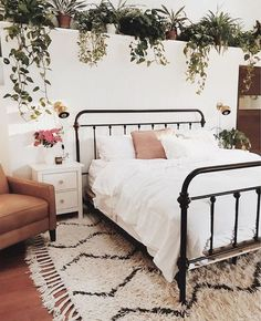 love the plants in this bedroom