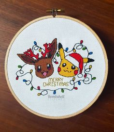 Eevee & Pikachu, Pokemon Christmas Cross Stitch Pattern -PDF PATTERN ONLY- Stitch And Pikachu, Pokemon Cross Stitch, Xmas Cross Stitch, Cross Stitch Bookmarks, Cross Stitch Animals, Cross Stitch Embroidery, Cross Stitch Patterns, Cross Stitches, Pokemon Christmas Ornaments