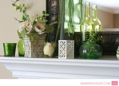 Spring fireplace mantle decor. I LOVE the colored vases!