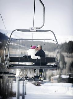 Chairlift wedding--- bride's ride with her dad on the way to the ceremony