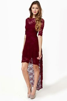 "We wished for a dress that would combine the sweetness of lace with the sexiness of sheer and behold: the Wish You Were Sheer Burgundy High-Low Lace Dress made our wish come true! This lacy stunner has a sweetheart neckline with sheer decolletage and short sleeves, while plunging open back is surrounded by sheer lace for extra sex appeal. High-low hem. Unlined and SHEER. Model is wearing a size small. Small measures 32"" long; 21"" longer at back. 14"" sleeve (from neckline). 21&q..."