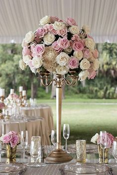 tall wedding centerpieces white and pink roses on a gold stand cat pennenga via instagram