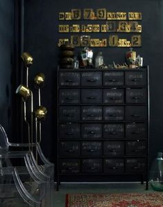 BRABBU loves the emphasis on black here. So dark, but yet, very warm interior and styling!   #black #style #cabinet #drawer #lamp #gold #design