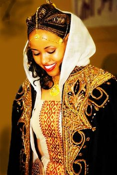 A beautiful Tigrai bride wearing a traditional wedding dress. The black coat is called Kabba. Northern Ethiopia is rich in culture and art.