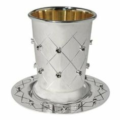 """Silver Plated Quilted & Floral Kiddush Wine Goblet & Coaster by Karshi. $35.00. Set Includes Cup and matching Coaster. 24 Kt. Gold Plated Inside. Dimensions: 3.1"""" x 4.7"""". Enhance your Shabbat & Yom Tov Holiday table with this elegant slver plated kiddush cup set. The inside of the cup is plated with 24 Kt. Gold. The quilted floral embossed design adds a beautiful touch making it the ideal gift for weddings, new homes, and just about any special occasion. Cup measures: 3.1"""" x 4.7"""""""