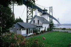 The Bristol Ferry Lighthouse is now a private home nestled under the Mount Hope Bridge in Bristol, RI.