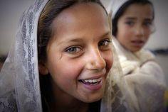 HERAT. AFGHANISTAN.  Portrait of a school girl, by Sebastian Rich.