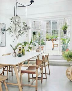 Light and bright dining area with a botanical feel.