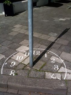 Sundial in Maastricht, Netherlands. I had this exact idea but someone beat me to it. Would be interesting to create street art installations using shadows though. You could use traffic signs and other urban objects to create fun art. Land Art, Urbane Kunst, Funny Drawings, Sundial, Wow Art, Street Art Graffiti, Guerrilla, Chalk Art, Art Fair