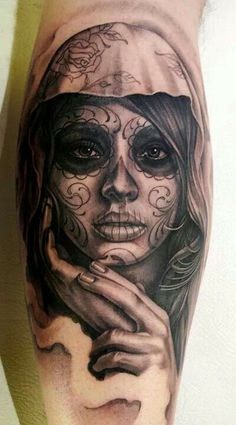 Really like this dia de las muertos tatt, done very classy by Eric Marcinizyn