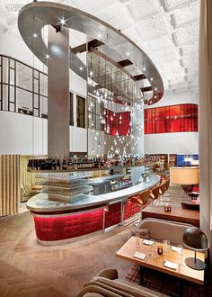 Virgin Terrain: Rockwell Group Europe Innovates at Virgin Hotels Chicago  Capped by a plaster ceiling, now restored, the onetime banking hall now houses a restaurant, the Commons Club.