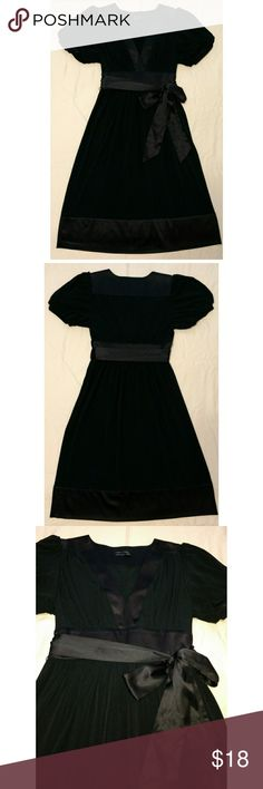 Fit & Flare, Puff Sleeved Black Dress EUC. Classic and elegant black dress with thick satiny accent trim on hem, neck, waist, shoulder and back of neck. Slightly higher waist accentuates narrowest part of waist to create a flattering shape. Comes with removable satiny waist tie. Im 5'4 and skirt falls few inches below knee. Max & Cleo Dresses