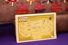 Table Map - We'd named all of our tables after places and trails we'd hiked during our relationship. So to give our guests and idea of where tables were we made a little trail map.  The picture is the tent layout as though it were a topographic map.  The sweetheart table was named Cloudland after the trail we were on when we got engaged.      Photo by Melissa Robotti  www.melissarobotti.com
