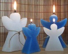 Kit com 4 velas em formato de anjos