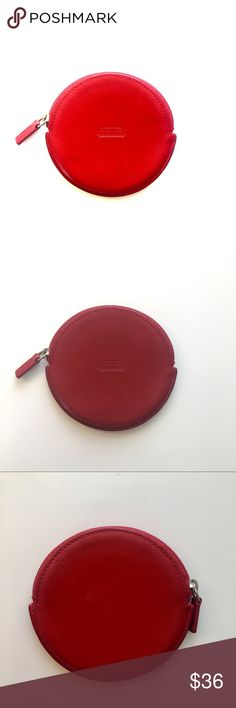 Coach Coin Purse Circular red leather coin purse. Some faint marks on the leather (see pics) but in very good condition and interior black leather also in great condition. Last photo has side by side with standard post-its for size reference. Color is somewhere between cherry red and ox-blood red, pretty true to the color in the 2nd and 3rd photos. Coach Bags Wallets