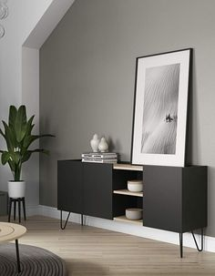 Nina is a sideboard that offers plenty of hidden storage and an open compartment, that interrupts the discreet lines of its design, giving it a twist. Available in lacquered white or black with light oak veneer. Furniture, Interior, Home, Apartment Interior, House Interior, Black Living Room, Home And Living, Interior Deco, Furniture Design