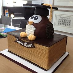Custom-made Owl Graduation Cake  AND it was red velvet on the inside! Best cake ever!! Made for my daughter