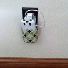 Cell phone holder  Made w/ baby magic bottle, fabric, and modge podge