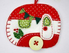 Vintage caravan trailer hanging ornament, handmade from felt and decorated with fabric scraps. With tiny felt bunting and buttons for the wheel and door knob. Colours are red and white with green deta Felt Christmas Ornaments, Christmas Fun, Christmas Movies, Christmas Sewing, Handmade Christmas, Felt Crafts, Holiday Crafts, Felt Bunting, Homemade Ornaments