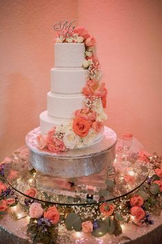 white buttercream wedding cake with coral and white roses by The Cake Zone - Bakers Ranch Wedding - Photo: Alisa Sue Photography - Orange Blossom Bride