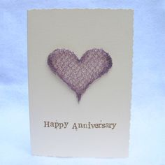 Anniversary Card: A Knitted Wire Heart Anniversary Card.  I LOVE to knit with wire so making this card is a real pleasure :) I knit the hearts using really thin 0.20mm wire, mould them in to shape and then sew the edges. Happy Anniversary stamped free hand on to the card *but remember, I can always change the occasion for all of my designs* An A6 260gsm Creative Linen cream card with deckled edge. Blank inside.