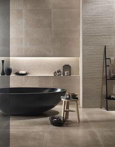 baignoire-ilot-noire-moderne-ovale-niche-murale-carrelage-beige