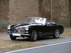 1974 MG Midget wish mine looked like that! Dude, they didn't look that good when they left the factory.