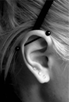 love this! industrial bar piercing