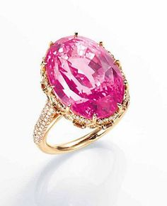 AN ATTRACTIVE PADPARADSCHA SAPPHIRE, COLOURED DIAMOND AND DIAMOND RING