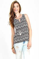 Ditzy Top: Black and white chevron mix fabric top. Features a flutter detail in the back. Pair this with colored denim and boots to complete the look.