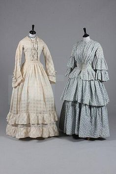 printed cotton day dress, circa 1855, with roller-printed design of small blue flowerheads and foliage, fan pleats falling from the shoulders coverge into shirring at the front waist, flounces to sleeves and skirt, together with a white trellis-weave muslin summer gown late 1850s-early 1860s, with wide pagoda sleeves, straight waistline, trimmed with blue ribbons and bows, ruffles to hem