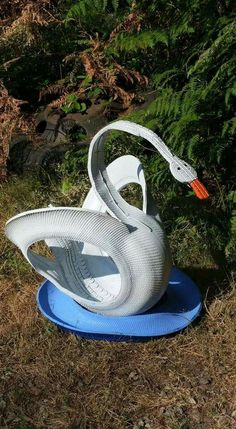 Swan from recycled tire by Beholders Eye on Facebook