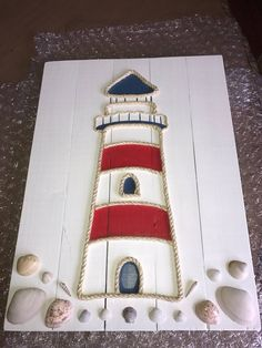 Seashell crafts Pallet - Handmade Lighthouse with Rope Beach Pallet Art Lighthouse Art Pallet Art Rope Art Coastal Decor Nautical Decor Nautical Art Nautical Signs Driftwood Crafts, Seashell Crafts, Beach Crafts, Seashell Projects, Driftwood Beach, Ocean Crafts, Diy Crafts, Decor Crafts, Nautical Signs