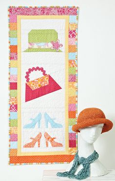 "Fashionista Get all dolled up with girly foundation pieced essentials. Designed by: Denise Starck, QM Graphic Designer Technique: Pieced and Foundation Pieced Size: Wall, 18"" x 42"" Appears in Quilts from Quiltmaker's 100 Blocks Spring '12. Buy this issue now."