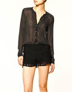 Wearing a polka dot blouse by Zara today.