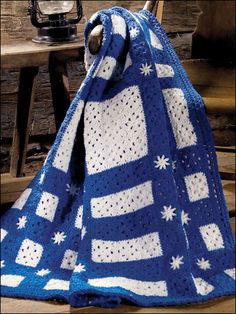 "Snowflakes in Blue Throw - Blue & white quilt-style throw with snowflake motifs is stitched with WW  yarn + size I hook. Size: 50"" x 67"". Skill Level: Intermediate Designed by Martha Brooks Stein free pdf"